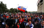 Russian fans celebrate after winning the opening match between Russia and Saudi Arabia during the 2018 soccer World Cup at the Luzhniki stadium in Moscow, Russia, Thursday, June 14, 2018. (AP Photo/Eduardo Verdugo)