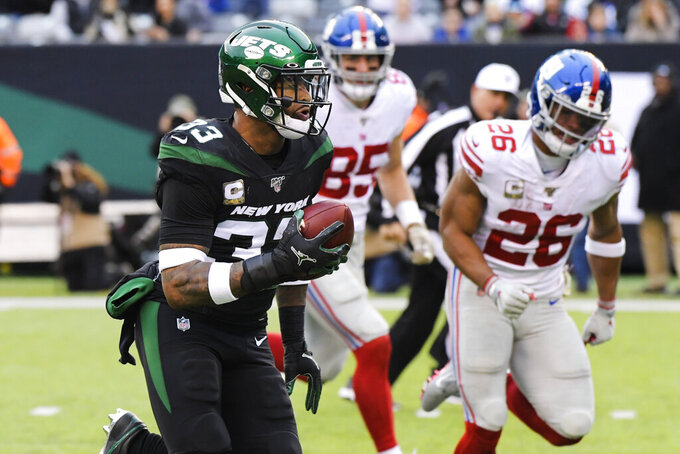FILE - In this Nov 10, 2019, file photo, New York Jets strong safety Jamal Adams (33) runs past New York Giants' Saquon Barkley (26) for a touchdown during the second half of an NFL football game in East Rutherford, N.J. A person with direct knowledge of the situation says Adams has requested a trade from the Jets amid a contract dispute. (AP Photo/Bill Kostroun, File)
