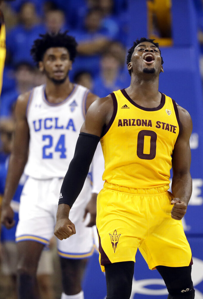 Arizona State guard Luguentz Dort (0) celebrates after scoring against UCLA during the second half of an NCAA college basketball game Thursday, Jan. 24, 2019, in Los Angeles. (AP Photo/Marcio Jose Sanchez)