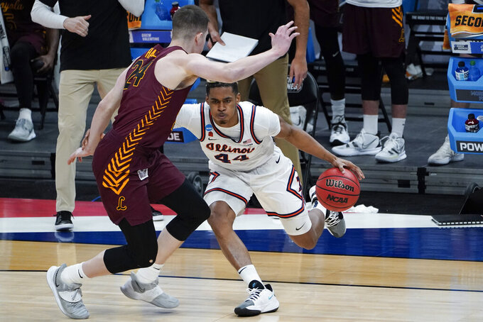 Illinois guard Adam Miller (44) drives on Loyola Chicago guard Tate Hall (24) during the first half of a men's college basketball game in the second round of the NCAA tournament at Bankers Life Fieldhouse in Indianapolis, Sunday, March 21, 2021. (AP Photo/Paul Sancya)
