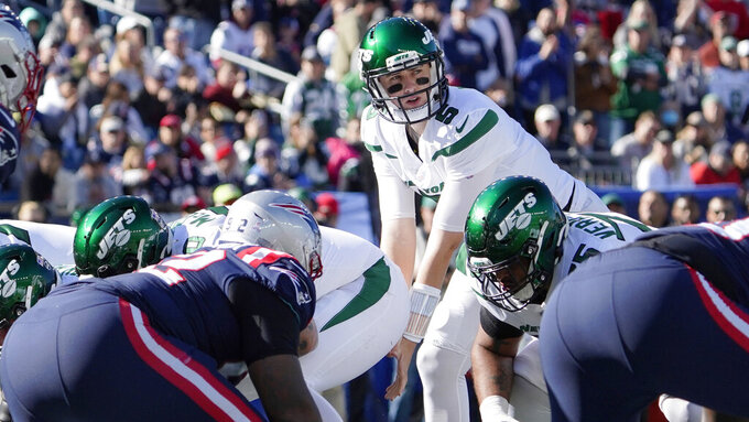 New York Jets quarterback Mike White (5) on the line of scrimmage, after replacing Jack Wilson, during the first half of an NFL football game against the New England Patriots, Sunday, Oct. 24, 2021, in Foxborough, Mass. (AP Photo/Mary Schwalm)