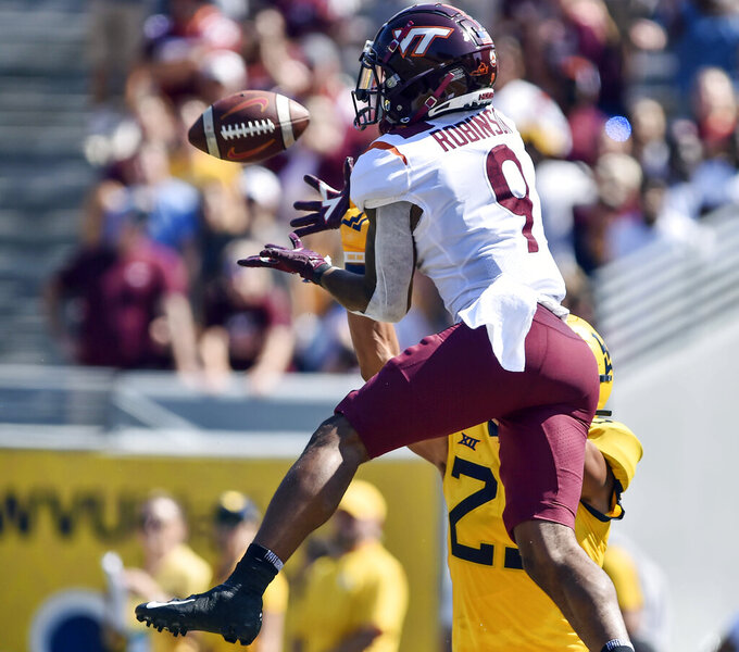 Virginia Tech wide receiver Tayvion Robinson (9) makes a catch for a touchdown against West Virginia during the first half of an NCAA college football game in Morgantown, W.Va., Saturday, Sept. 18, 2021. (AP Photo/William Wotring)