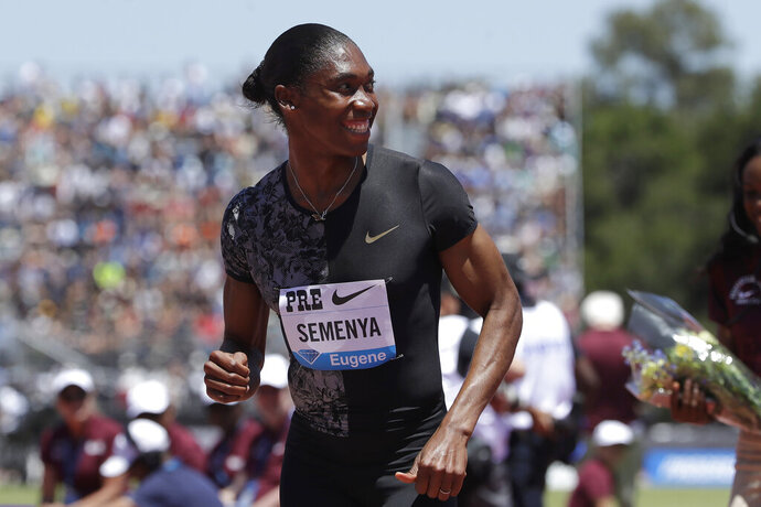 FILE - In this June 30, 2019 file photo, South Africa's Caster Semenya smiles after winning the women's 800-meter race during the Prefontaine Classic, an IAAF Diamond League athletics meeting, in Stanford, Calif. Olympic champion Caster Semenya has run her first public race in eight months and says she will be back in top-level track despite currently being banned from competing in her favorite event. (AP Photo/Jeff Chiu, File)