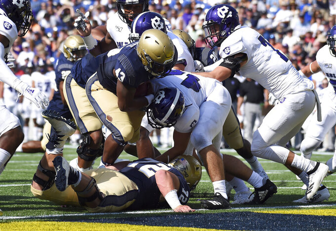Navy's Nelson Smith scores on a run against Holy Cross during an NCAA college football game, Saturday, Aug. 31, 2019, in Annapolis, Md. (Paul W. Gillespie/Capital Gazette via AP)