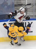 Arizona Coyotes' Jakob Chychrun (6) checks Nashville Predators' Craig Smith (15) during the first period of NHL qualifying round game action in Edmonton, on Tuesday, Aug. 4, 2020.  (Jason Franson/The Canadian Press via AP)