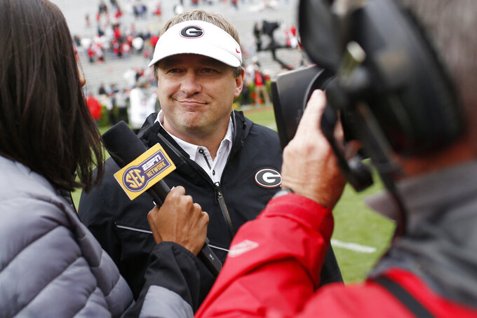 FILE - In this April 20, 2019, file photo, Georgia coach Kirby Smart speaks with the media after an NCAA college football spring game in Athens, Ga. For the first time, the defending national champion Clemson Tigers are No. 1 in The Associated Press preseason Top 25 presented by Regions Bank, Monday, Aug. 19, 2019. Alabama is No. 2, Georgia is No. 3. (Joshua L. Jones/Athens Banner-Herald via AP, File)