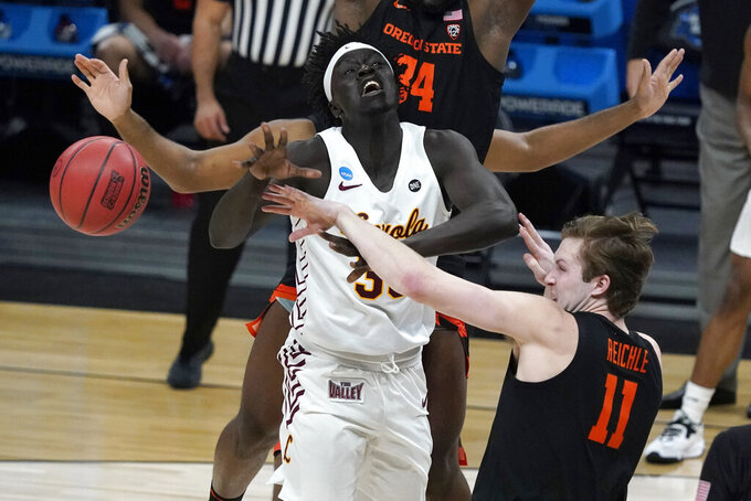 Oregon State guard Zach Reichle (11) knocks the ball away from Loyola Chicago forward Aher Uguak during the first half of a Sweet 16 game in the NCAA men's college basketball tournament at Bankers Life Fieldhouse, Saturday, March 27, 2021, in Indianapolis. (AP Photo/Jeff Roberson)