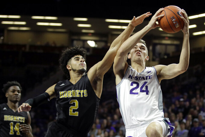 Kansas State's Pierson McAtee (24) shoots under pressure from Alabama State's Kevin Holston (2) during the first half of an NCAA college basketball game Wednesday, Dec. 11, 2019, in Manhattan, Kan. (AP Photo/Charlie Riedel)