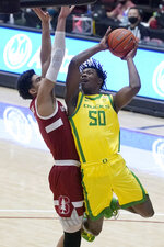 Oregon forward Eric Williams Jr. (50) shoots against Stanford forward Jaiden Delaire during the first half of an NCAA college basketball game in Stanford, Calif., Thursday, Feb. 25, 2021. (AP Photo/Jeff Chiu)