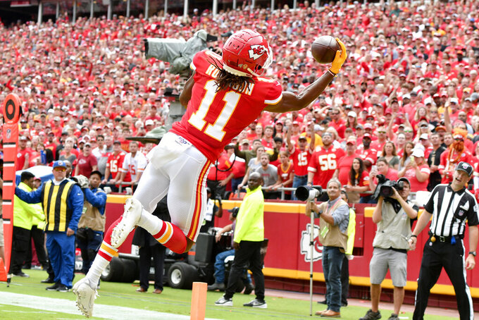 Kansas City Chiefs wide receiver Demarcus Robinson (11) makes a one-handed touchdown catch during the first half of an NFL football game against the Baltimore Ravens in Kansas City, Mo., Sunday, Sept. 22, 2019. (AP Photo/Ed Zurga)