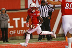 Utah running back Devonta'e Henry-Cole (7) scores against Washington State in the first half of an NCAA college football game Saturday, Sept. 28, 2019, in Salt Lake City. (AP Photo/Rick Bowmer)
