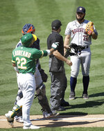 Oakland Athletics' Ramon Laureano (22) gestures to Houston Astros pitcher Humberto Castellanos, right, after being hit by a pitch thrown by Castellanos in the seventh inning of a baseball game Sunday, Aug. 9, 2020, in Oakland, Calif. (AP Photo/Ben Margot)