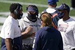 New England Patriots head coach Bill Belichick, center, consults with defensive coaches in the first half of an NFL football game against the Denver Broncos, Sunday, Oct. 18, 2020, in Foxborough, Mass. (AP Photo/Charles Krupa)