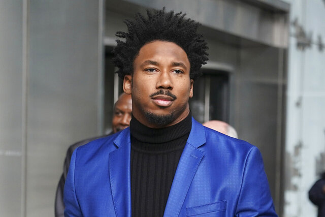 FILE - In this Nov. 20, 2019, file photo, Cleveland Browns star defensive end Myles Garrett leaves an office building in New York. Suspended Browns star defensive end Myles Garrett met Monday, Feb. 10, 2020, with NFL Commissioner Roger Goodell to discuss his possible reinstatement, a person familiar with the meeting told The Associated Press. (AP Photo/Seth Wenig, File)