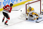Nashville Predators goalie Pekka Rinne, right, blocks a shot by Chicago Blackhawks center Kirby Dach during the third period of an NHL hockey game in Chicago, Thursday, Jan. 9, 2020. (AP Photo/Nam Y. Huh)