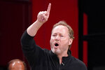 Milwaukee Bucks head coach Mike Budenholzer gestures toward his players during the first half of Game 2 of an NBA basketball second-round playoff series against the Brooklyn Nets, Monday, June 7, 2021, in New York. (AP Photo/Kathy Willens)
