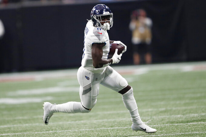 Tennessee Titans wide receiver A.J. Brown (11) runs against the Atlanta Falcons during the first half of an NFL football game, Sunday, Sept. 29, 2019, in Atlanta. (AP Photo/John Bazemore)