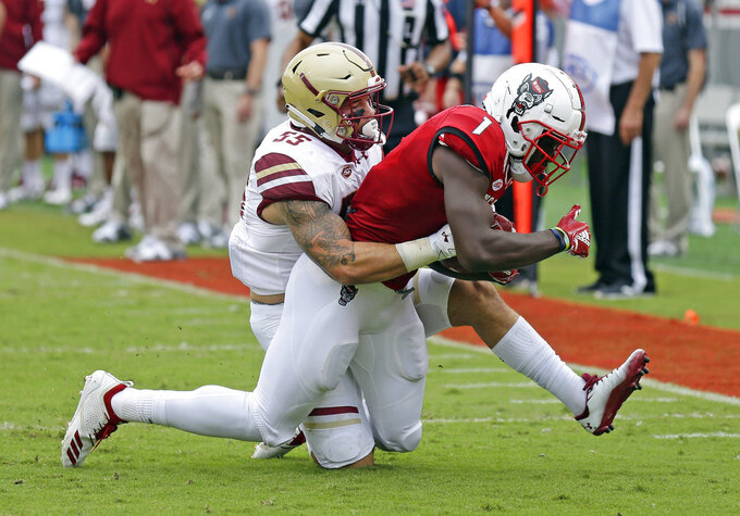 North Carolina State's Stephen Louis (1) is tackled by Boston College's Isaiah McDuffie (55) during the first half an NCAA college football game in Raleigh, N.C., Saturday, Oct. 6, 2018. (AP Photo/Gerry Broome)