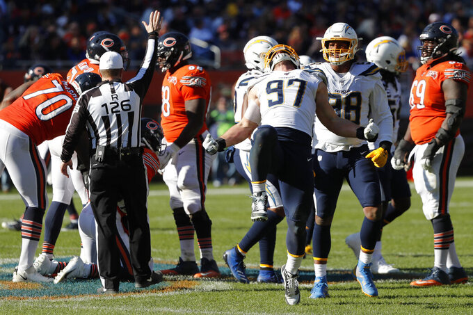 Los Angeles Chargers defensive end Joey Bosa (97) celebrates after sacking Chicago Bears quarterback Mitchell Trubisky during the second half of an NFL football game, Sunday, Oct. 27, 2019, in Chicago. (AP Photo/Charles Rex Arbogast)