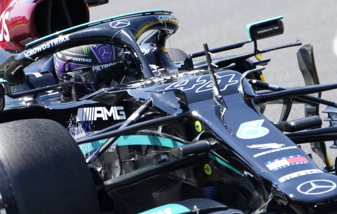 Mercedes driver Lewis Hamilton of Britain steers his car during the first free practice at the Hungaroring racetrack in Mogyorod, Hungary, Friday, July 30, 2021. The Hungarian Formula One Grand Prix will be held on Sunday. (AP Photo/Darko Bandic)