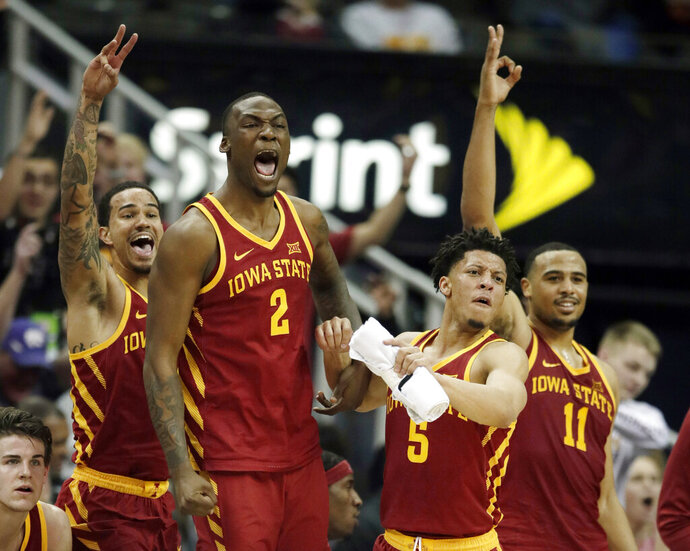 Iowa State players, from left, guard Nick Weiler-Babb, Cameron Lard (2), Lindell Wigginton (5) and Talen Horton-Tucker (11) celebrate from the bench during the second half of an NCAA college basketball game against Baylor in the quarterfinals of the Big 12 conference tournament in Kansas City, Mo., Thursday, March 14, 2019. Iowa State defeated Baylor 83-66. (AP Photo/Orlin Wagner)
