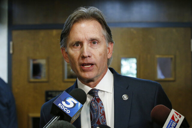 FILE - In this Oct. 15, 2019, file photo, Oklahoma Attorney General Mike Hunter talks with reporters in Norman, Okla. The Oklahoma State Department of Health is reversing course on its decision to no longer release COVID-19 data by city and zip code. The agency announced the move on Wednesday, June 3, 2020, after consulting with Attorney General Mike Hunter. (AP Photo/Sue Ogrocki, File)