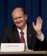 FILE - In this Thursday, Sept. 16, 2010, file photo, Delaware Democratic Senate candidate Chris Coons waves after being introduced during a candidate forum, in Wilmington, Del. On the national level, U.S. Sen. Chris Coons is facing a Democratic primary challenge from progressive newcomer Jessica Scarane, who believes Coons' desire for bipartisanship has made him too willing to compromise with Republicans. (AP Photo/Rob Carr, File)