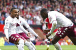 Aston Villa's Kortney Hause, right, celebrates after scoring his side's opening goal during the English Premier League soccer match between Manchester United and Aston Villa at the Old Trafford stadium in Manchester, England, Saturday, Sept 25, 2021. (AP Photo/Jon Super)