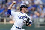 Kansas City Royals starting pitcher Brady Singer throws during the first inning of a baseball game against the Minnesota Twins Friday, July 2, 2021, in Kansas City, Mo. (AP Photo/Charlie Riedel)