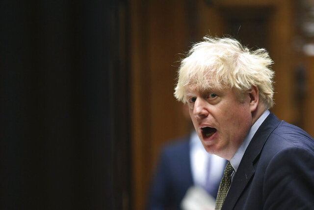 In this photo released by UK Parliament, Britain's Prime Minister Boris Johnson speaks, during Prime Minister's Questions in the House of Commons, London, Wednesday, Oct. 14, 2020.  Johnson is being criticized by all sides two days after announcing his three-tier approach. A report Tuesday showed that the government's science advisers had urged it to impose much tougher measures, including a two- to three-week national lockdown. (Jessica Taylor/UK Parliament via AP)