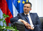Slovenia's prime minister Marjan Sarec listens to reporter's question during an interview with the Associated Press in Ljubljana, Slovenia, Tuesday, April 23, 2019. (AP Photo/Darko Bandic)