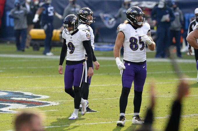 Baltimore Ravens kicker Justin Tucker (9) walks to the sideline after missing a 52-yard field goal attempt against the Tennessee Titans in the second half of an NFL wild-card playoff football game against the Tennessee Titans Sunday, Jan. 10, 2021, in Nashville, Tenn. (AP Photo/Mark Zaleski)