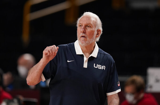 United States' head coach Gregg Popovich reacts during men's basketball preliminary round game between United States and Iran at the 2020 Summer Olympics, Wednesday, July 28, 2021, in Saitama, Japan. (AP Photo/Charlie Neibergall)
