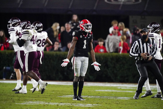 Georgia wide receiver George Pickens (1) reacts after a play during the first half of the team's NCAA college football game against Mississippi State, Saturday, Nov. 21, 2020, in Athens, Ga. (AP Photo/Brynn Anderson)