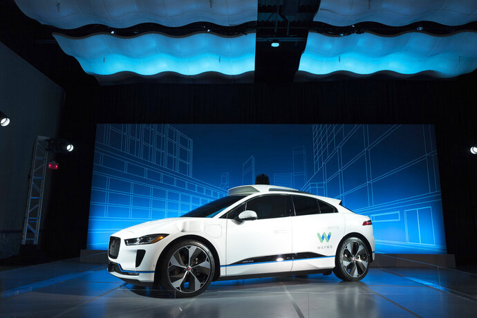 FILE - In this March 27, 2018 file photo, the Jaguar I-Pace vehicle outfitted with Waymo's suite of sensors and radar is introduced in New York. Google autonomous vehicle spinoff Waymo says it will start testing on public roads in Florida to better experience heavy rain. (AP Photo/Mark Lennihan, File)