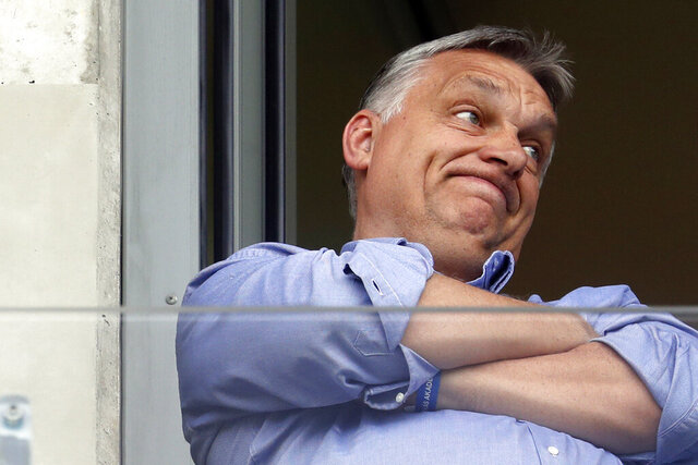 FILE - In this May 19, 2019 file photo, Hungarian Prime Minister Viktor Orban watches a soccer game in his hometown of Felcsut, Hungary. Six Hungarian opposition parties have announced that they will unite in an effort to unseat Prime Minister Viktor Orban and his ruling Fidesz party in 2022 national elections.  (AP Photo/Laszlo Balogh)