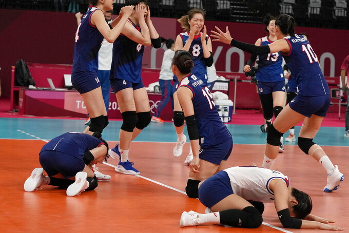 South Korean players celebrate winning the women's volleyball quarterfinal match between South Korea and Turkey at the 2020 Summer Olympics, Wednesday, Aug. 4, 2021, in Tokyo, Japan. (AP Photo/Frank Augstein)