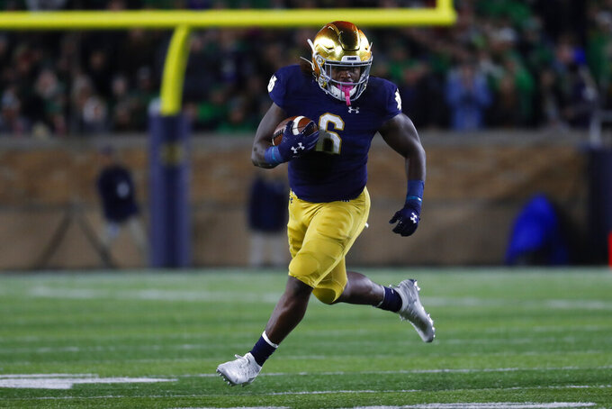 Notre Dame running back Tony Jones Jr. runs the ball against Southern California in the first half of an NCAA college football game in South Bend, Ind., Saturday, Oct. 12, 2019. (AP Photo/Paul Sancya)