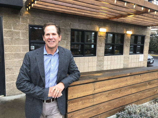 In this Jan. 27, 2020, photo, Knute Buehler, a Republican candidate for a seat in the U.S. House of Representatives, poses for a photo during an interview with The Associated Press in Bend, Ore. In 2018, the Republican party's candidate for governor of Oregon painted himself as a centrist, criticized President Donald Trump's environmental stance and said he didn't want to be linked to divisive national figures. Buehler lost to incumbent Gov. Kate Brown. Now, Buehler is running for a seat in Congress in a district covering a conservative swath of Oregon, and has taken Trump into a tight embrace. (AP Photo/Andrew Selsky)