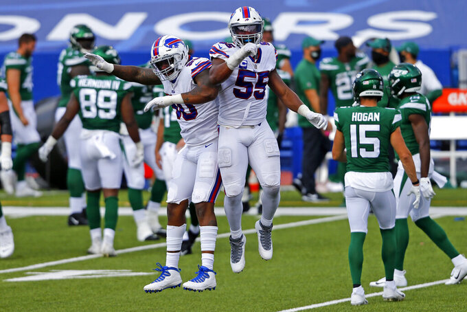 Buffalo Bills defensive end Jerry Hughes (55) celebrates his fumble recovery with defensive end Quinton Jefferson during the second half of an NFL football game against the New York Jets in Orchard Park, N.Y., Sunday, Sept. 13, 2020. (AP Photo/Jeffrey T. Barnes)