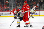 Detroit Red Wings defenseman Madison Bowey (74) checks Buffalo Sabres center Jeff Skinner (53) off the puck in the first period of an NHL hockey game Friday, Oct. 25, 2019, in Detroit. (AP Photo/Paul Sancya)