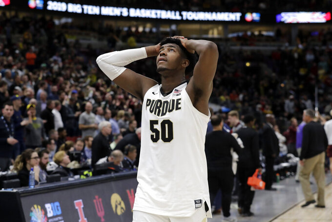 Purdue's Trevion Williams (50) reacts as he walks off the court after an NCAA college basketball game against the Minnesota in the quarterfinals of the Big Ten Conference tournament, Friday, March 15, 2019, in Chicago. Minnesota won 75-73. (AP Photo/Nam Y. Huh)