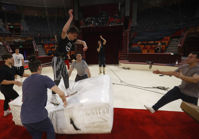 Kevin Richter's jumping group rehearses at the Capital Circus in Budapest, Hungary, April 20, 2021. A state of emergency was declared in Hungary only a day before the troupe was to begin its spring season last year, and pandemic restrictions limiting events and public gatherings have meant the circus hasn't brought in any income since.(AP Photo/Laszlo Balogh)