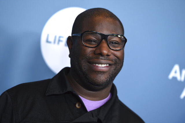 """FILE - Steve McQueen arrives at The Hollywood Reporter's Women in Entertainment Breakfast in Los Angeles on Dec. 5, 2018. In a movie year mostly lacking big, ambitious releases, McQueen's """"Small Axe"""" anthology is an unqualified main event. While many other filmmakers are on hold, the """"12 Years a Slave"""" director has raced to finish not one but five new films. The movies, spanning 1968 to 1985, are each individual stories of the West Indian community in London. (Photo by Jordan Strauss/Invision/AP, File)"""