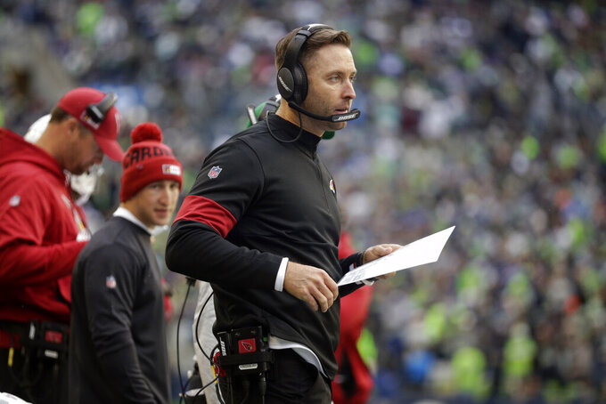 Arizona Cardinals head coach Kliff Kingsbury wears a headset on the sideline during the first half of an NFL football game against the Seattle Seahawks, Sunday, Dec. 22, 2019, in Seattle. (AP Photo/Lindsey Wasson)