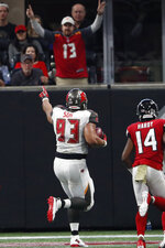 Tampa Bay Buccaneers nose tackle Ndamukong Suh (93) runs into the end zone for a touchdown after Atlanta Falcons quarterback Matt Ryan fumbled during the second half of an NFL football game, Sunday, Nov. 24, 2019, in Atlanta. The Tampa Bay Buccaneers won 35-22. (AP Photo/John Bazemore)