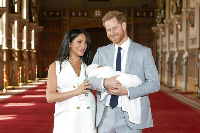 FILE - Britain's Prince Harry and Meghan, Duchess of Sussex, pose with their newborn son Archie Harrison Mountbatten-Windsor in St George's Hall at Windsor Castle, Windsor, south England, on May 8, 2019. It won't be long before Archie is a big brother. His mother is due to give birth to a baby girl sometime this summer. Hopefully, the introduction of the new sibling will go smoothly, but seasoned parents and pediatric experts warn that the transition takes preparation and diligence. (Dominic Lipinski/Pool via AP, File)