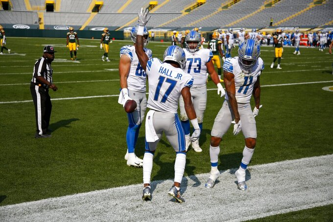 Detroit Lions' Marvin Hall celebrates his touchdown catch during the second half of an NFL football game against the Green Bay Packers Sunday, Sept. 20, 2020, in Green Bay, Wis. (AP Photo/Matt Ludtke)