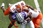 Bowling Green linebacker Jerry Roberts (33) and defensive back Jamari Bozeman (13) tackle Kansas State wide receiver Chabastin Taylor (13) during the first half of an NCAA college football game Saturday, Sept. 7, 2019, in Manhattan, Kan. (AP Photo/Charlie Riedel)