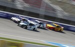 Matt Tifft (36), Denny Hamlin (11), Brad Keselowski (2), and Joey Logano (22) drive during a practice session for the NASCAR cup series race at Michigan International Speedway, Friday, June 7, 2019, in Brooklyn, Mich. (AP Photo/Carlos Osorio)